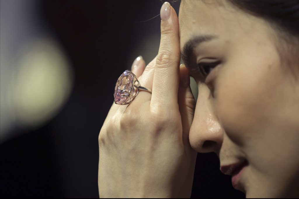 A model displays the Pink Star, a 59.60-carat internally flawless fancy vivid pink diamond during an auction preview at Sotheby's in Hong Kong, China, 29 March 2017. The Pink Star, the largest internally flawless fancy vivid pink diamond ever graded by the GIA, will go on sale in Hong Kong on 04 April and is estimated to fetch in excess of 60 million US dollars.Pink Star diamond at Sotheby's auction preview, Hong Kong, China - 29 Mar 2017