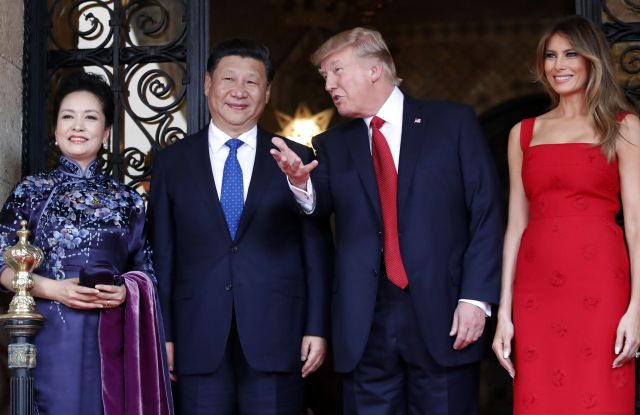 President Donald Trump talks with Chinese President Xi Jinping