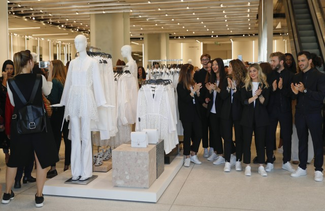 Zara staff applaud during the opening of the world's biggest Zara store in Madrid, Spain, 07 April 2017. The Spanish clothing retailer's store measures 6,000 square meters and is located in downtown Madrid.Zara opens its' biggest worldwide store in Madrid, Spain.