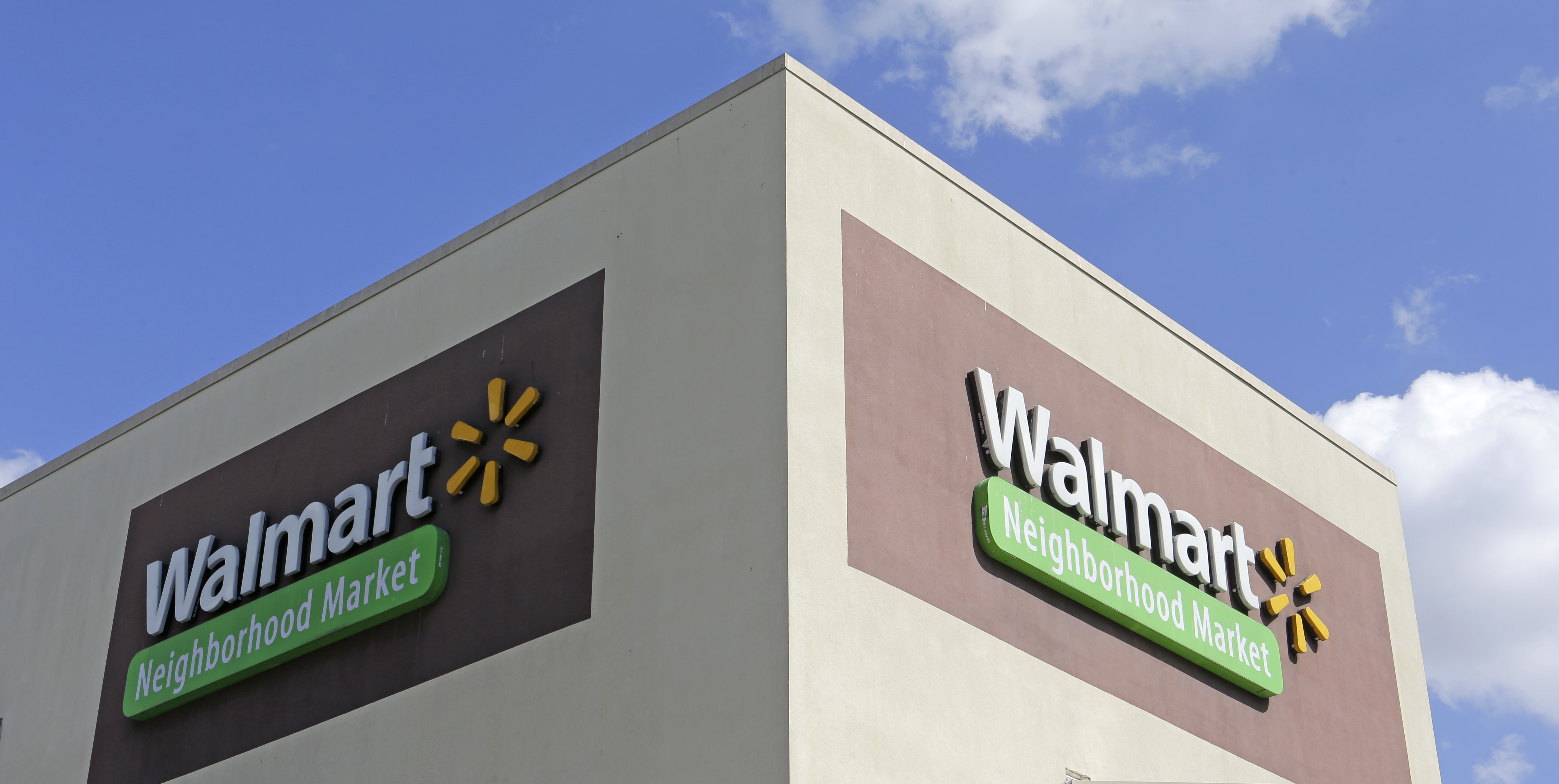 Copyright 2017 The Associated Press. All rights reserved. This material may not be published, broadcast, rewritten or redistributed without permission.Mandatory Credit: Photo by AP/REX/Shutterstock (8607154a)This, photo shows Wal-Mart signage at one of the company's neighborhood markets, in Hialeah, Fla. Starting April 19, 2017, Wal-Mart says it will offer discounts on thousands of online-only items when customers elect to have them shipped to one of the company's stores for pickupWal-Mart-Pickup-Discount, Hialeah, USA - 08 Feb 2017