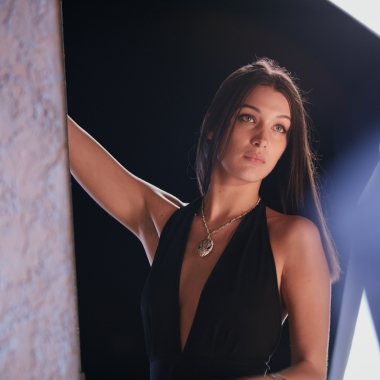 A behind-the-scenes shot of Bella Hadid starring in Bulgari's Goldea The Roman Night ad campaign.