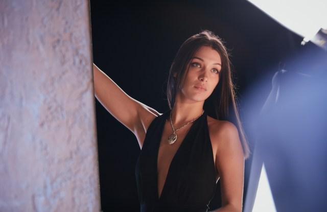 A behind-the-scenes shot of Bella Hadid starring in Bulgari's Goldea The Roman Night ad campaign.