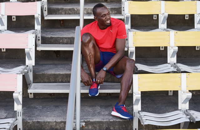 Usain Bolt wearing shoes featuring Puma's new Netfit lacing technology.