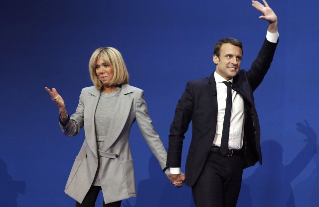 Emmanuel Macron and Brigitte TrogneuxFirst round of the French presidential elections 2017, Paris, France - 23 Apr 2017French presidential election candidate for the 'En Marche!' (Onwards!) political movement, Emmanuel Macron (R) celebrates with his wife Brigitte Trogneux (L) after the first round of the French presidential elections in Paris, France, 23 April 2017. Media reports that polling agencies projections place Macron and far-right Front National (FN) party candidate Marine Le-Pen in the lead positions for the vote. France will hold the second round of the presidential elections on 07 May 2017.