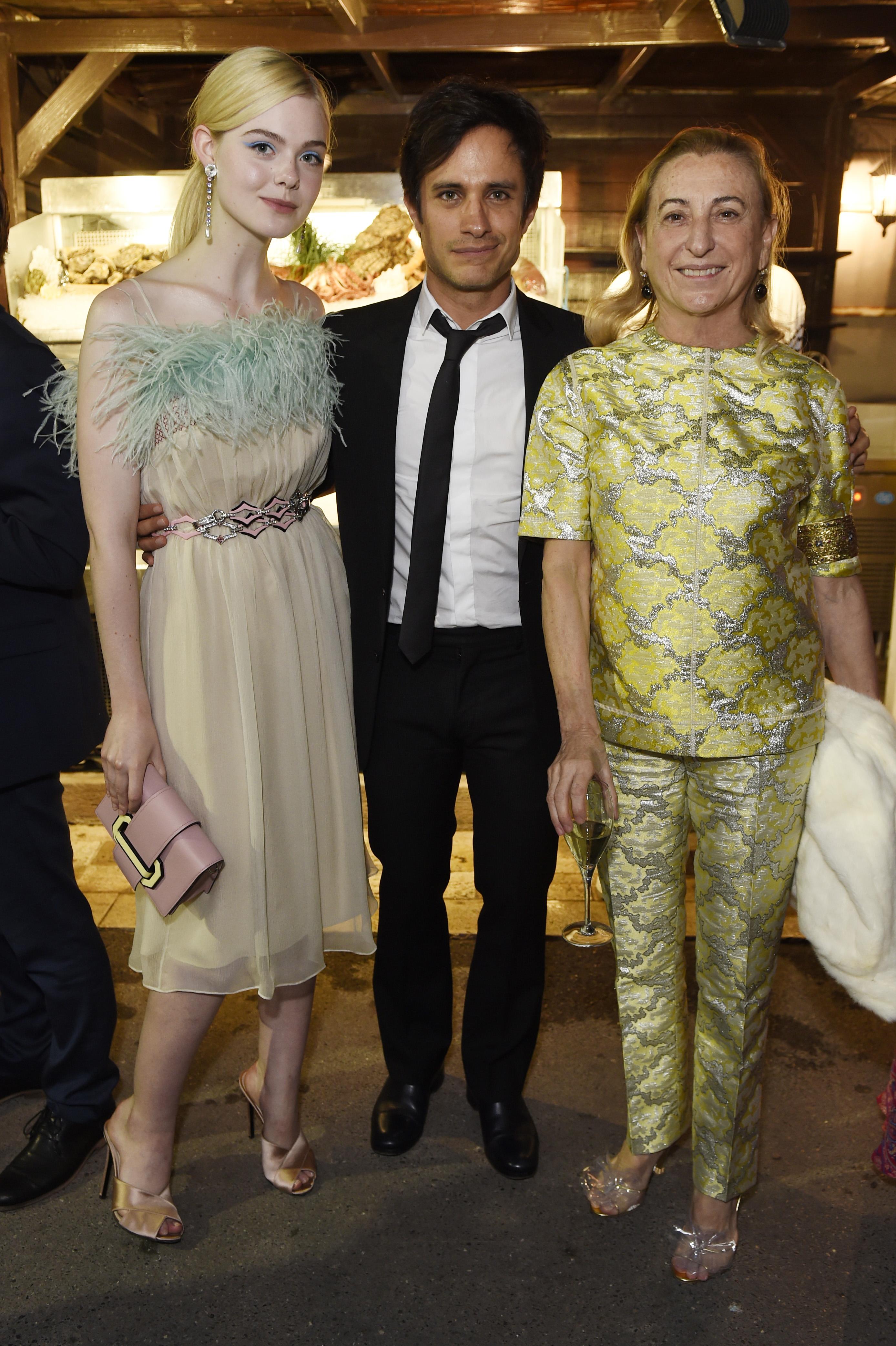 Elle Fanning, Gael García Bernal and Miuccia Prada.