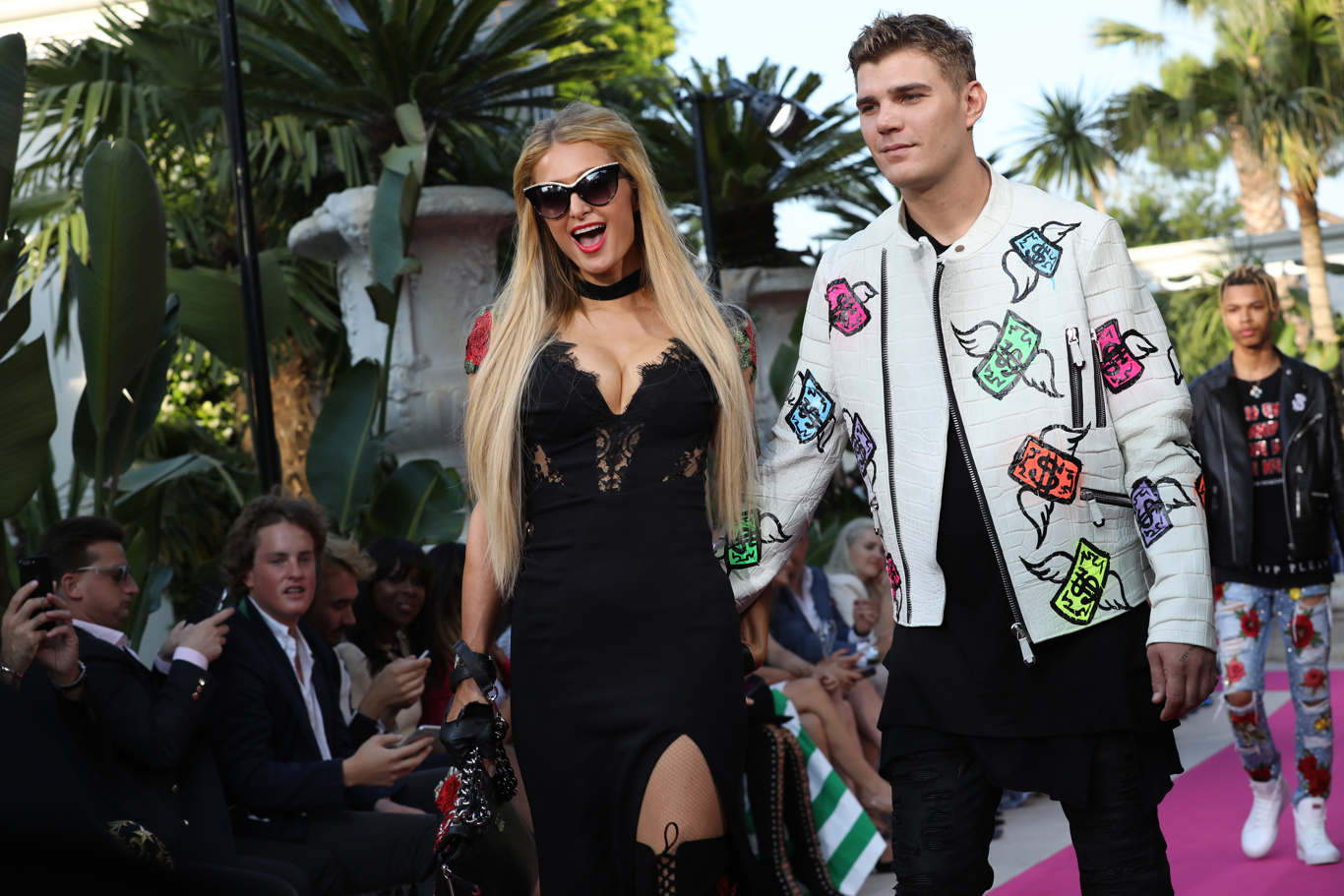 Paris Hilton and boyfriend Chris Zylka at Philipp Plein's show at his villa during Cannes Film Festival.