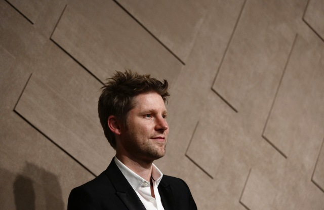Fashion designer Christopher Bailey poses during the opening ceremony of the new Burberry flagship store in Hong Kong. Burberry PLC replaced Christopher Bailey as its CEO, ending the project of having him both lead the fashion house and serve as its chief creative officerBurberry CEO, Hong Kong