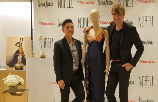 Student winner Anthony Galante with his design with Ken Downing, senior vice president and fashion director of Neiman Marcus.