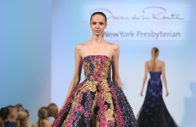 Models walk the runway wearing fashion from the Oscar de la Renta Fall collection during the NewYork-Presbyterian Hospital Lying-In Luncheon event on Tuesday, May 9, 2017, in New York. (Stuart Ramson/AP Images for NewYork-Presbyterian)