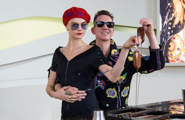 Cara Delevingne and Jeremy Scott make their own personalized Magnum at the Magnum x Moschino launch event in Cannes, France.