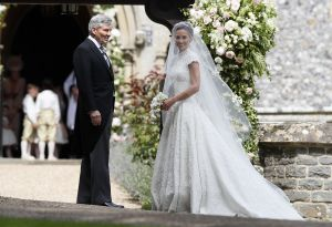 Copyright 2017 The Associated Press. All rights reserved. This material may not be published, broadcast, rewritten or redistributed without permission.Mandatory Credit: Photo by AP/REX/Shutterstock (8825723v) Pippa Middleton arrives with her father Michael Middleton for her wedding to James Matthews at St Mark's Church in Englefield, England . Middleton, the sister of Kate, Duchess of Cambridge is to marry hedge fund manager James Matthews in a ceremony Saturday where her niece and nephew Prince George and Princess Charlotte are in the wedding party, along with sister Kate and princes Harry and William Britain Pippa Middleton, Englefield, United Kingdom - 20 May 2017