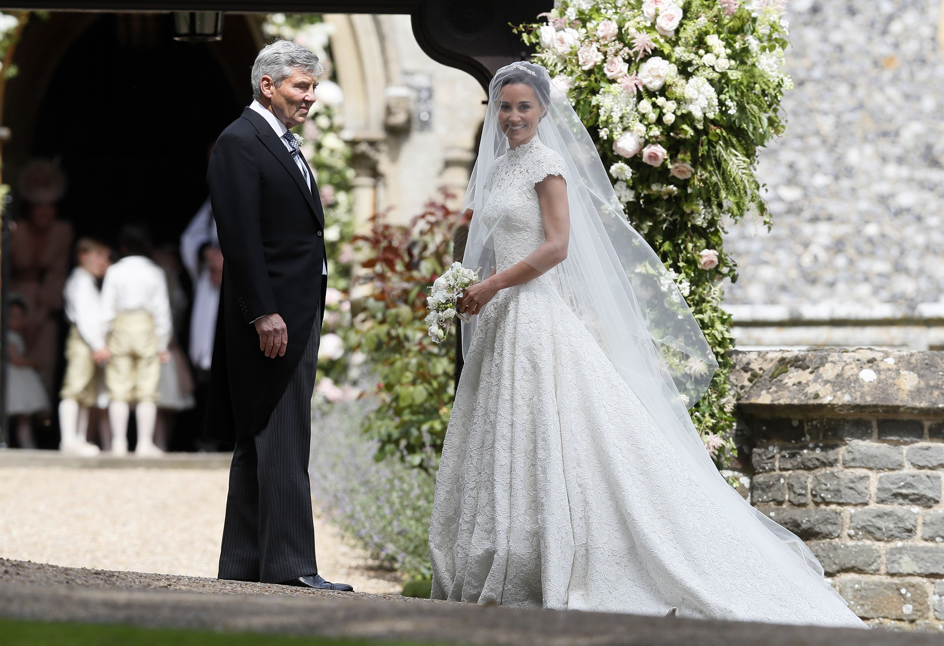 Pippa Middleton wedding Pippa Middleton (in Giles Deacon) arrives with her father Michael Middleton