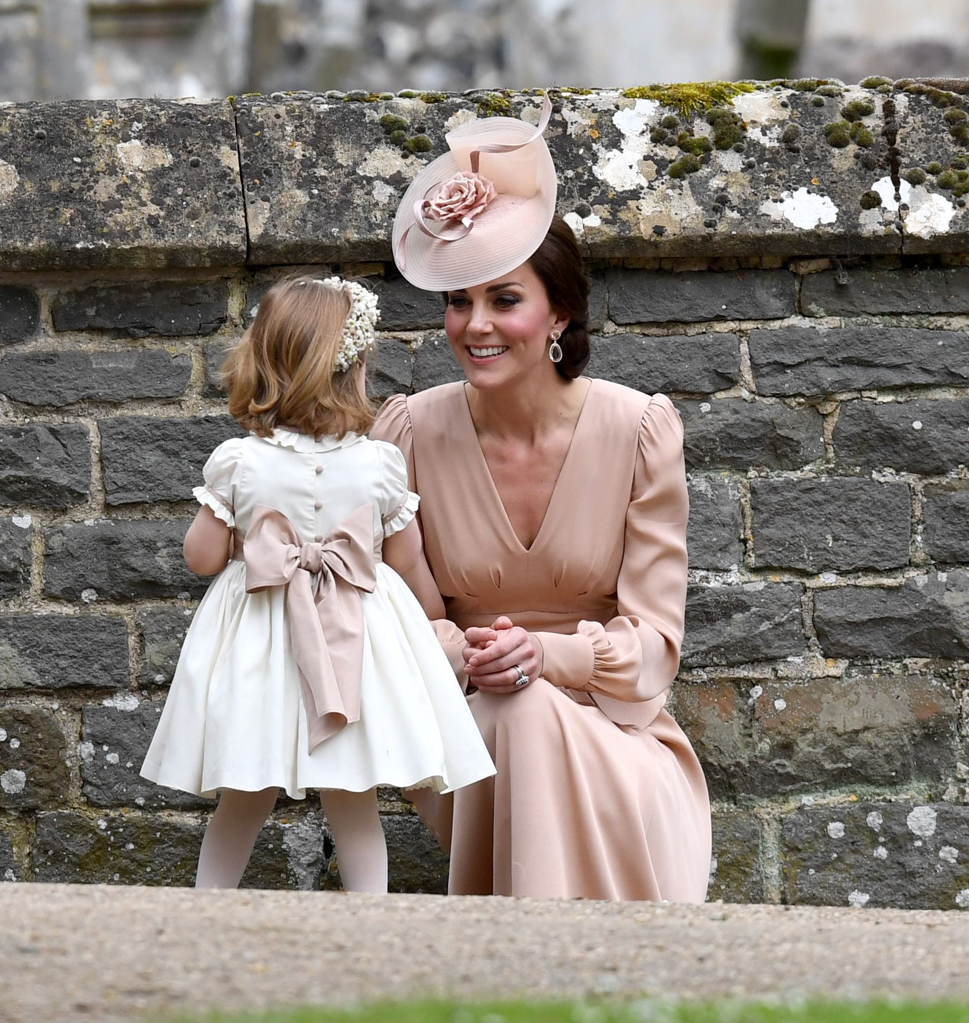 Duchess of Cambridge and Princess Charlotte at the wedding of James Matthews and Pippa Middleton