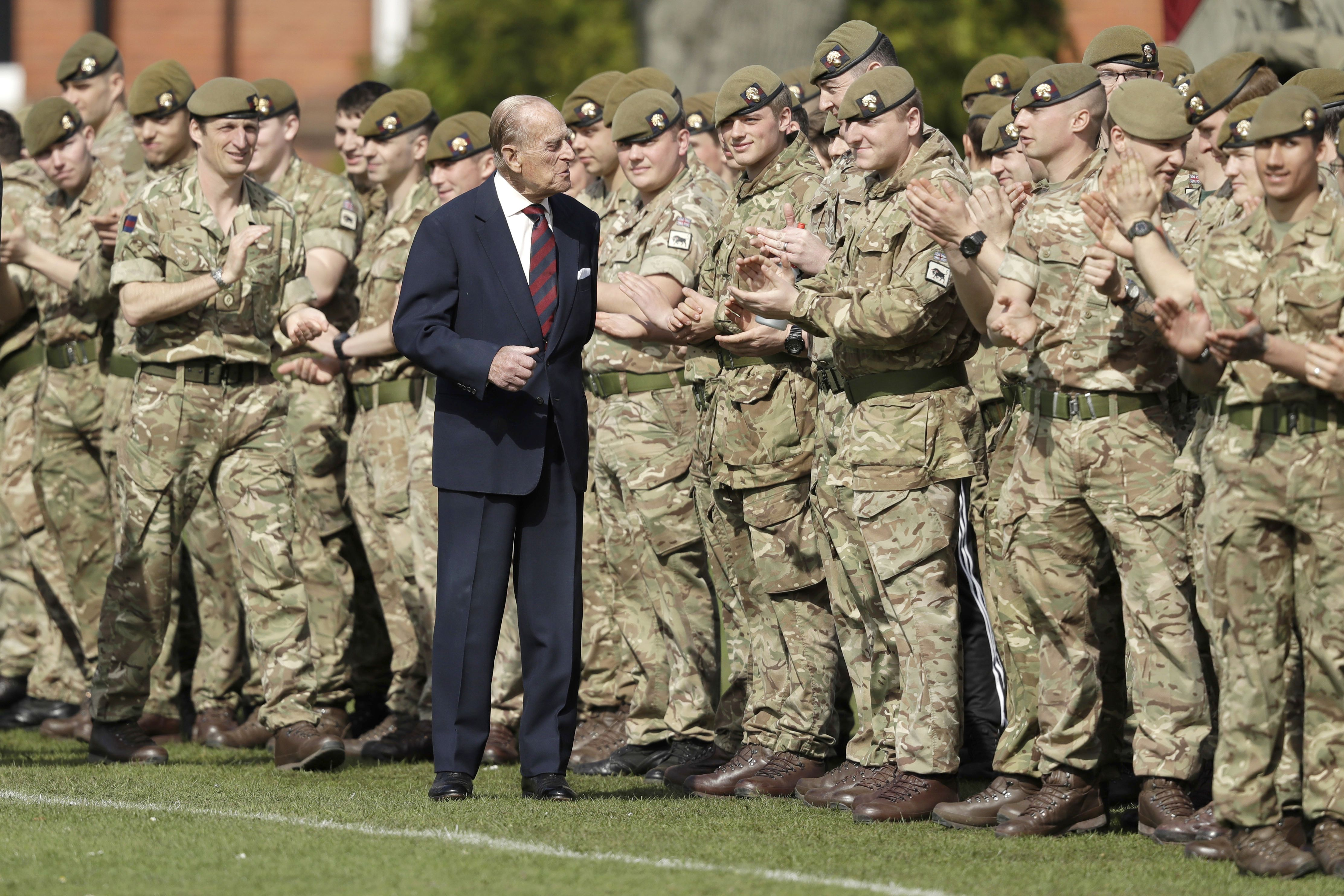 Prince Philip, in his capacity of Colonel, Grenadier Guards, chats with members of the 1st Battalion Grenadier Guards as they applaud the final whistle from the sidelines, of the Manchester Cup inter-company football match at Lille BarracksManchester Cup inter-company football match, Lille Barracks, Aldershot, UK - 30 Mar 2017The Duke of Edinburgh on Thursday presented the Manchester Trophy to the winners of the Manchester Cup, met Sergeants' in their Mess and stayed for lunch in the Officers' Mess
