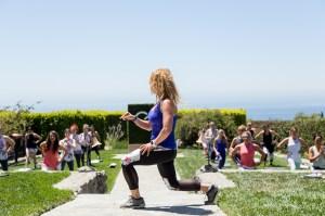 Eve Overland leads a workout wearing Calia