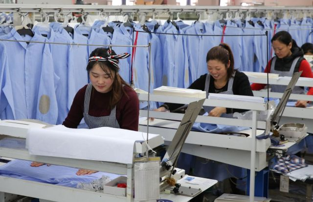 Chinese garment workers in a factory in the manufacturing hub of Dongguan.