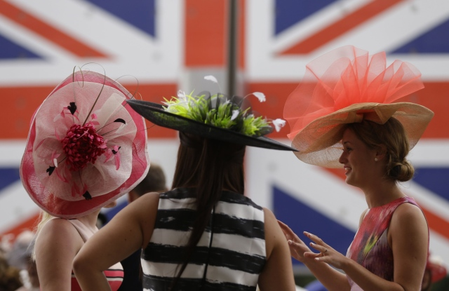 Racegoes chat as they wait for the racing to begin on the third day of the Royal Ascot horse race meeting, which is traditionally known as Ladies Day, in Ascot, EnglandBritain Royal , Ascot, United Kingdom - 22 Jun 2017