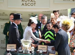 Prince William and the Duchess of Cambridge (in Alexander McQueen) present a trophy to jockey John Velazquez at Royal Ascot