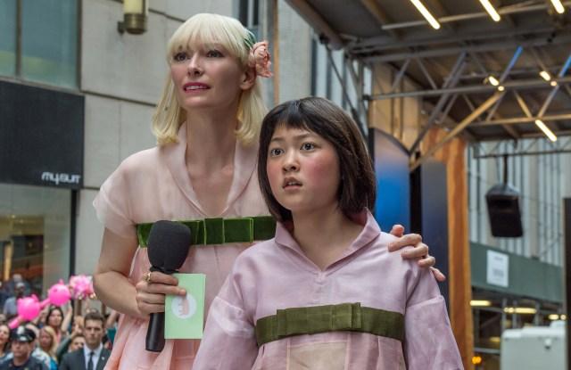 Tilda Swinton as Lucy Mirando and An Seo Hyun as Mija in OKJA.
