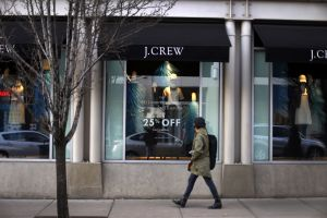 In this March 24, 2014 photo, a pedestrian passes a J.Crew store in the Shadyside shopping district of Pittsburgh. The Commerce Department reports on retail sales for March onRetail Sales, Pittsburgh, USA