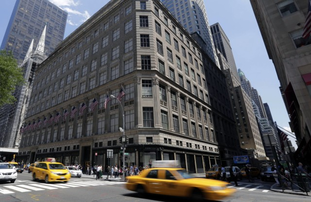 Taxis pass Saks flaship store on New York's Fifth Avenue, . Saks Inc. agreed to sell itself to Hudson's Bay Co., the Canadian parent of upscale retailer Lord & Taylor, for about $2.4 billion in a deal that will bring luxury to more North American localesSaks Acquisition, New York, USA