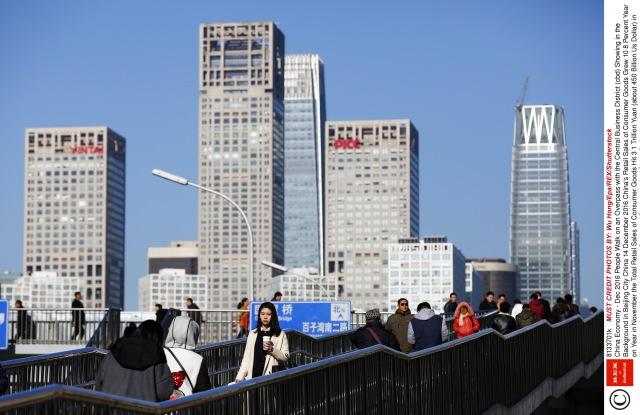 People Walk on an Overpass with the Central Business District (cbd) Showing in the Background in Beijing City China 14 December 2016 China's Retail Sales of Consumer Goods Grew 10 8 Percent Year on Year in November the Total Retail Sales of Consumer Goods Hit 3 1 Trillion Yuan (about 450 Billion Us Dollar) in November According to the National Bureau of Statistics (nbs) China BeijingChina Economy - Dec 2016