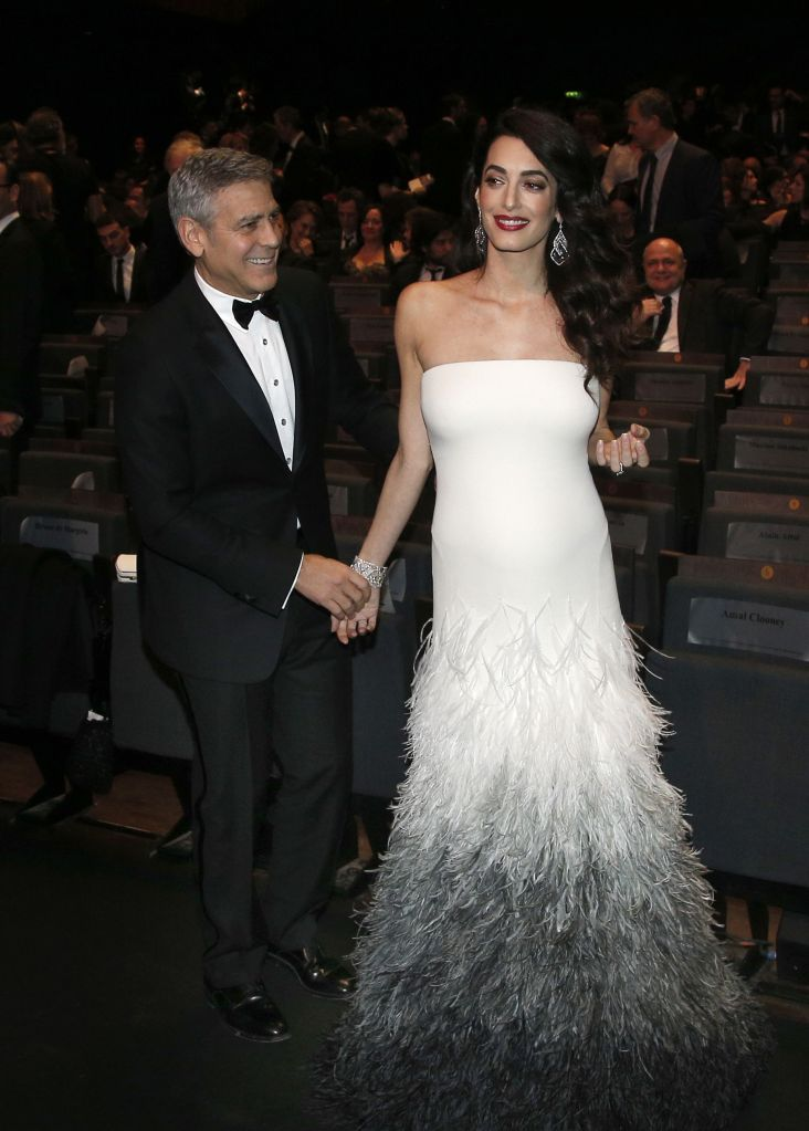 Copyright 2017 The Associated Press. All rights reserved. This material may not be published, broadcast, rewritten or redistributed without permission.Mandatory Credit: Photo by AP/REX/Shutterstock (8434857a)Actor George Clooney and Amal Clooney arrive at the 42nd Cesar Film Awards ceremony at Salle Pleyel in Paris,. This annual ceremony is presented by the French Academy of Cinema Arts and Techniques42nd Annual Cesar Film Awards, Paris, France - 24 Feb 2017