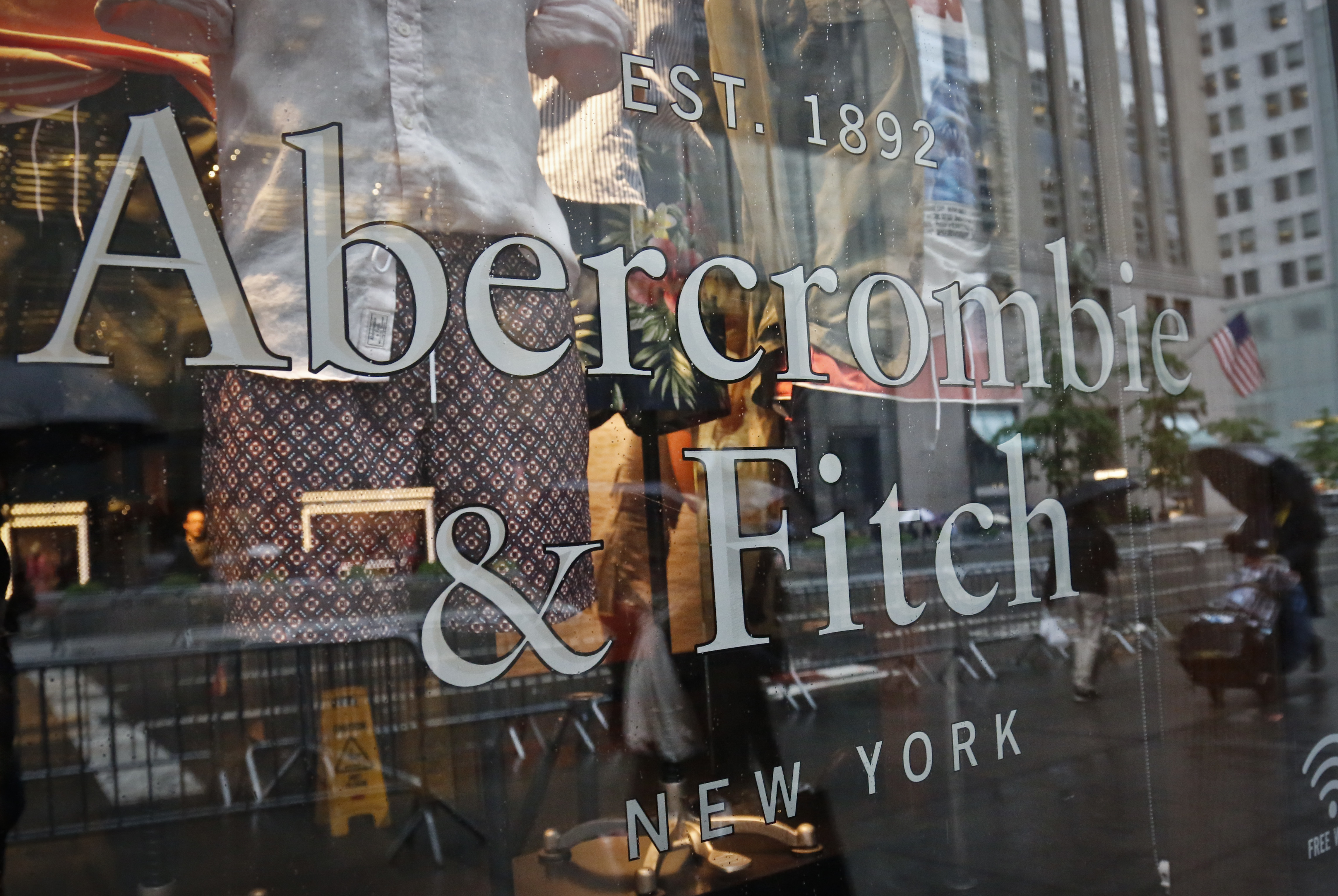 Copyright 2017 The Associated Press. All rights reserved. This material may not be published, broadcast, rewritten or redistributed without permission.Mandatory Credit: Photo by AP/REX/Shutterstock (8840628b)A store window reflects a street scene at an Abercrombie & Fitch store on New York's Fifth Avenue. Abercrombie & Fitch Company reports earnings, Thursday, May 25, 2017Earns Abercrombie Fitch, New York, USA - 22 May 2017