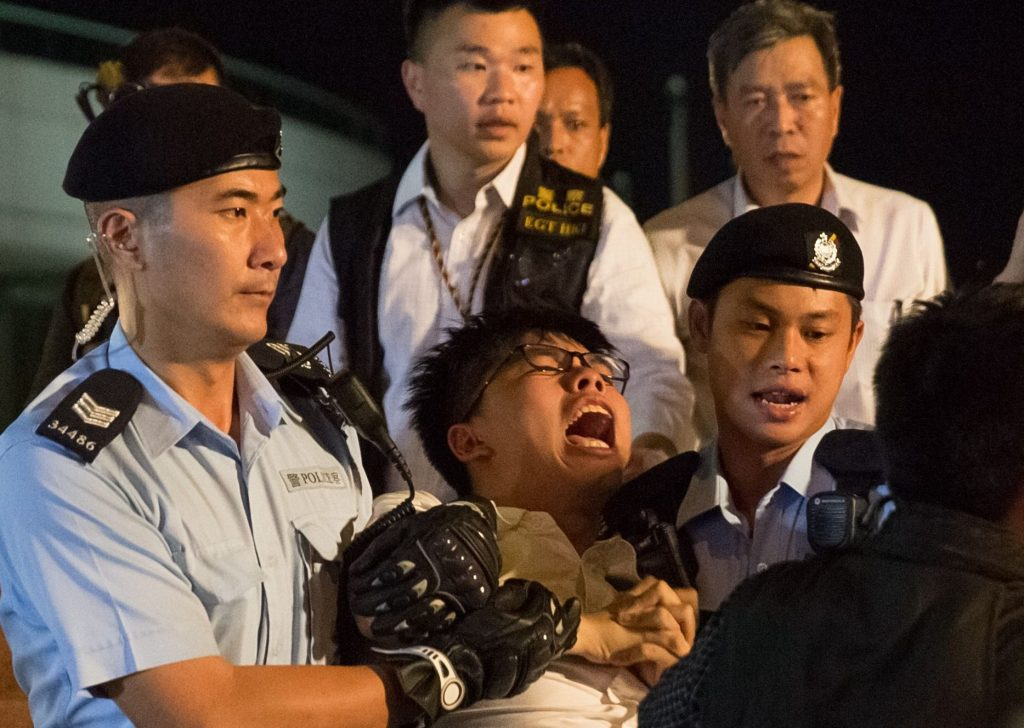 Joshua Wong, the leader of the Occupy 2014 movement, was arrested Wednesday protesting the arrival of President Xi.
