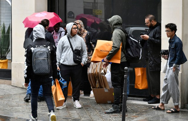 People queueing for the Louis Vuitton x Supreme launch in Paris.