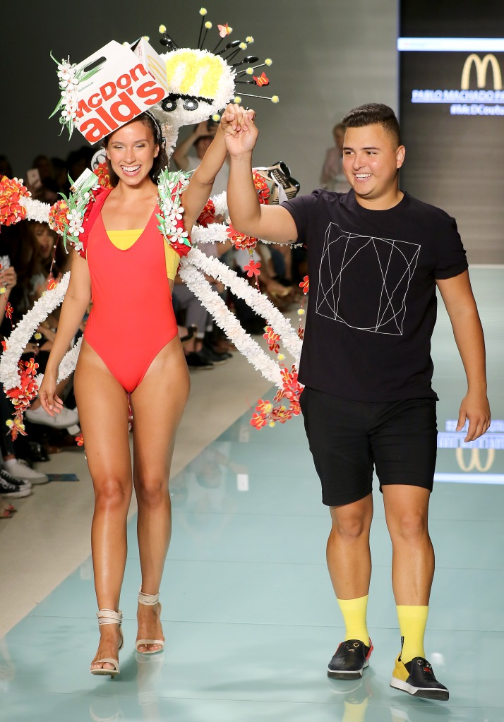 MIAMI, FL - JULY 20: A model walks the runway with Miami international University of Art and Design Fashion Student Pablo Machado Palomeque, winner of the McDCouture Design Challenge $5000 scholarship, at McDCouture Makes A Splash At Miami Swim Week at 2100 Collins Ave. on July 20, 2017 in Miami, Florida. Designed by Miami international University of Art and Design Fashion Student Pablo Machado Palomeque, winner of the McDCouture Design Challenge $5000 scholarship. This heavenly set of wings features fry box flowers, a bundle box headset and 7000 butterflies made from sandwich wrappers. The entire look was creatively constructed with 10 Soft Baked Cookie boxes, 20 Filet-o-Fish boxes, 700 Burrito wrappers, 20 Signature Crafted Sandwich boxes, 100 McFlurry cups, 100 Bundle boxes, 150 Apple Pie boxes, 50 Happy Meal boxes, 400 Bacon Egg & Cheese Bagel wrappers and 400 fry boxes. (Photo by Alexander Tamargo/Getty Images for McDonald's)