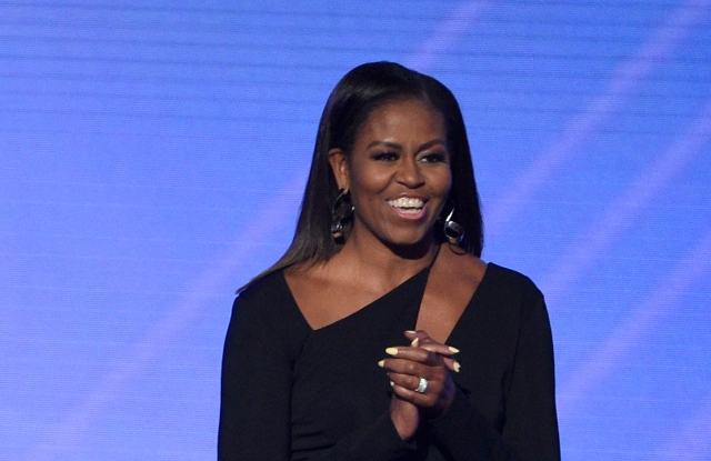 Former first lady Michelle Obama walks on stage to present the Arthur Ashe Courage Award at the ESPYS at the Microsoft Theater on Wednesday, July 12, 2017, in Los Angeles. (Photo by Chris Pizzello/Invision/AP)