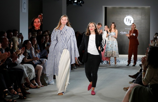 : Designer Lara Krude (R) is seen with a model on the runway after accepting the fashion talent award 'Designer for Tomorrow' by Peek & Cloppenburg and Fashion ID hosted by Stella McCartney during the Mercedes-Benz Fashion Week Berlin Spring/Summer 2018 at Kaufhaus Jandorf on July 6, 2017 in Berlin, Germany. (Photo by Andreas Rentz/Getty Images for P&C and Fashion ID) *** Local Caption *** Lara Krude