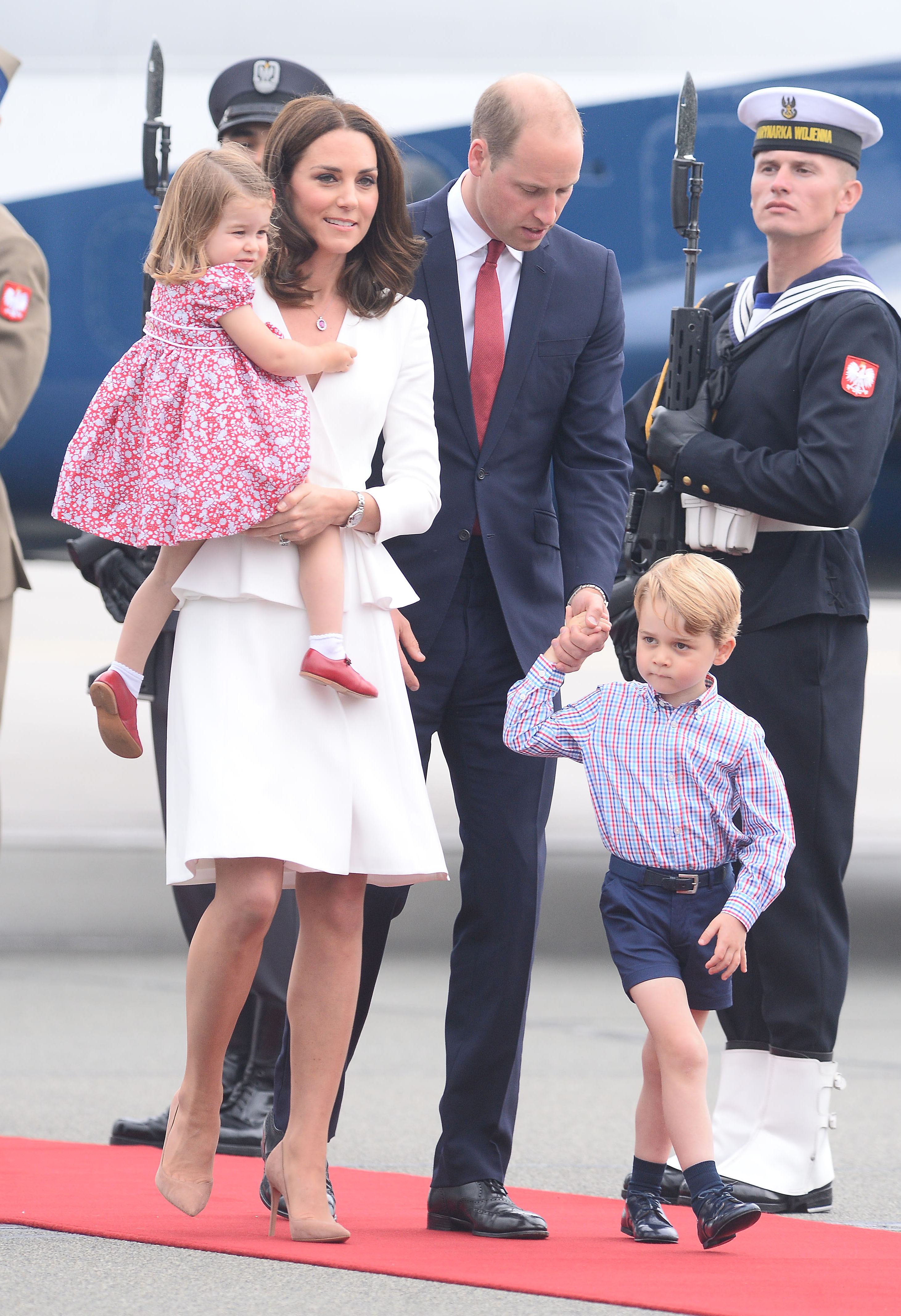 The Duchess of Cambridge (in Alexander McQueen), Princess Charlotte, Prince William and Prince George