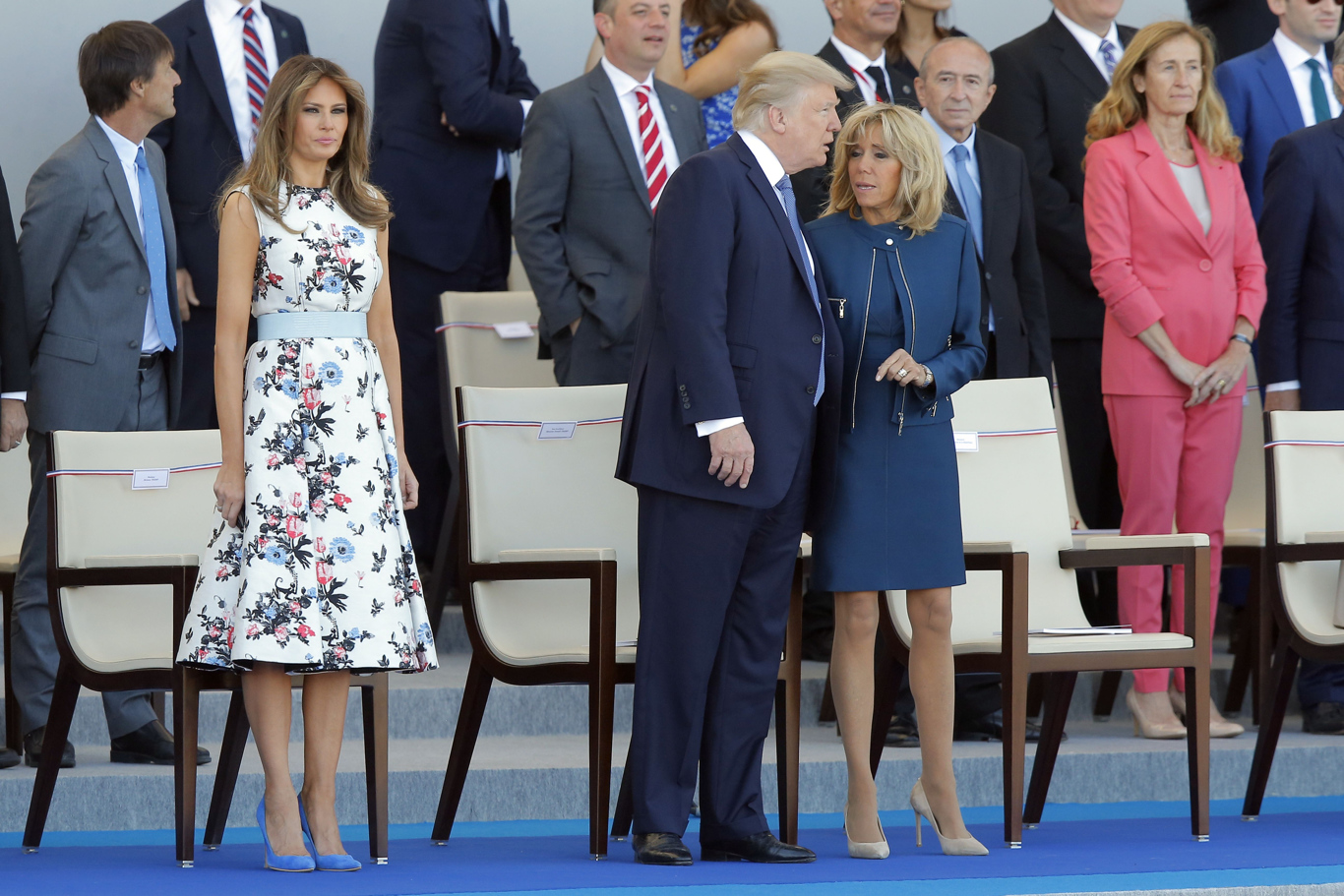 Brigitte Macron, wife of French President Emmanuel Macron, discusses with U.S. President Donald Trump while U.S. First Lady Melanie Trump looks, prior to the traditional Bastille Day military parade on the Champs Elysees, in ParisBastille Day, Paris, France - 14 Jul 2017