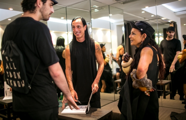 Rick Owens and Michèle Lamy sign a copy of their book.