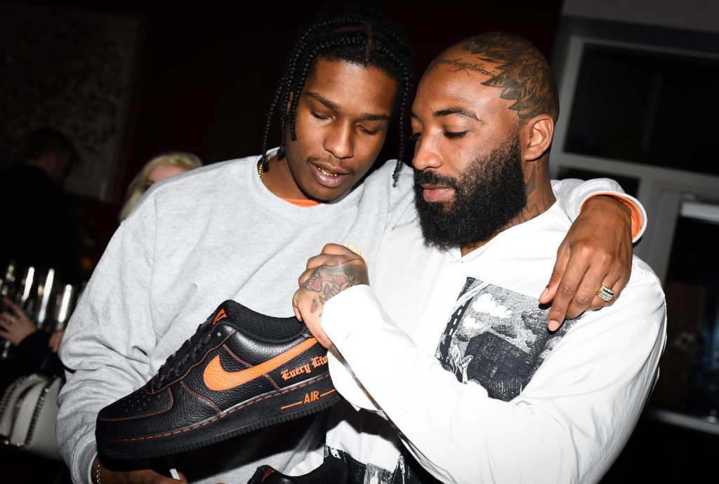 Rapper A$AP Rocky (left) and A$AP Bari (right) holding a Nike x Vlone sneaker.