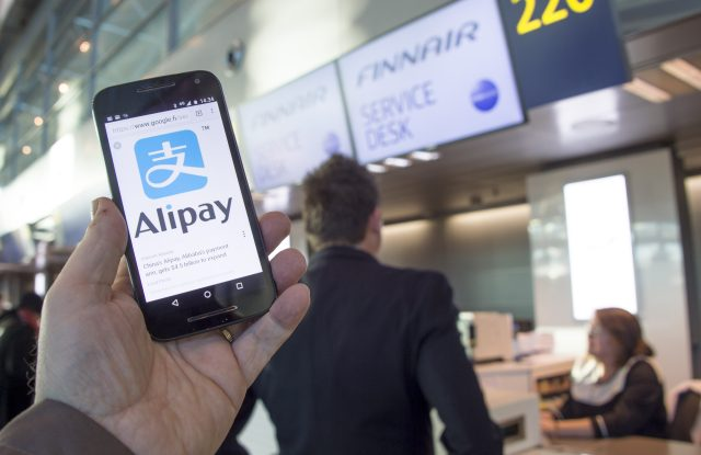 An Alipay-app on a smartphone screen and Finnair logos at the Helsinki airport, Finland, 27 January 2017. Finnish flag carrier Finnair said it will launch Alipay as an official method of in-flight payments for customers travelling on carrier's Asian route between Helsinki and Shanghai. Alipay is the mobile payment platform of Chinese Ant Financial. Finnair is the first airline to accept payments via Alipay.Finnair accepts Alipay for payments on passenger planes on its Asian routes, Vantaa, Finland - 27 Jan 2017