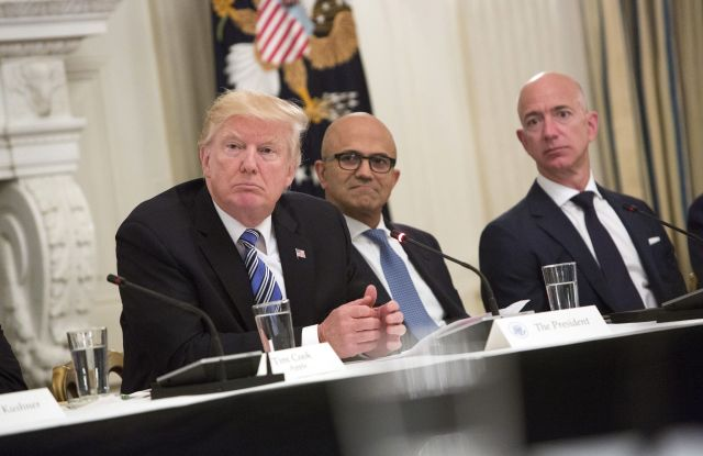 United States President Donald J. Trump (left) participates in an American Technology Council roundtable with corporate and eduction leaders including Microsoft CEO Satya Narayan (center) and Amazon CEO Jeff Bezos (right).White House tech summit, Washington DC, USA - 19 Jun 2017