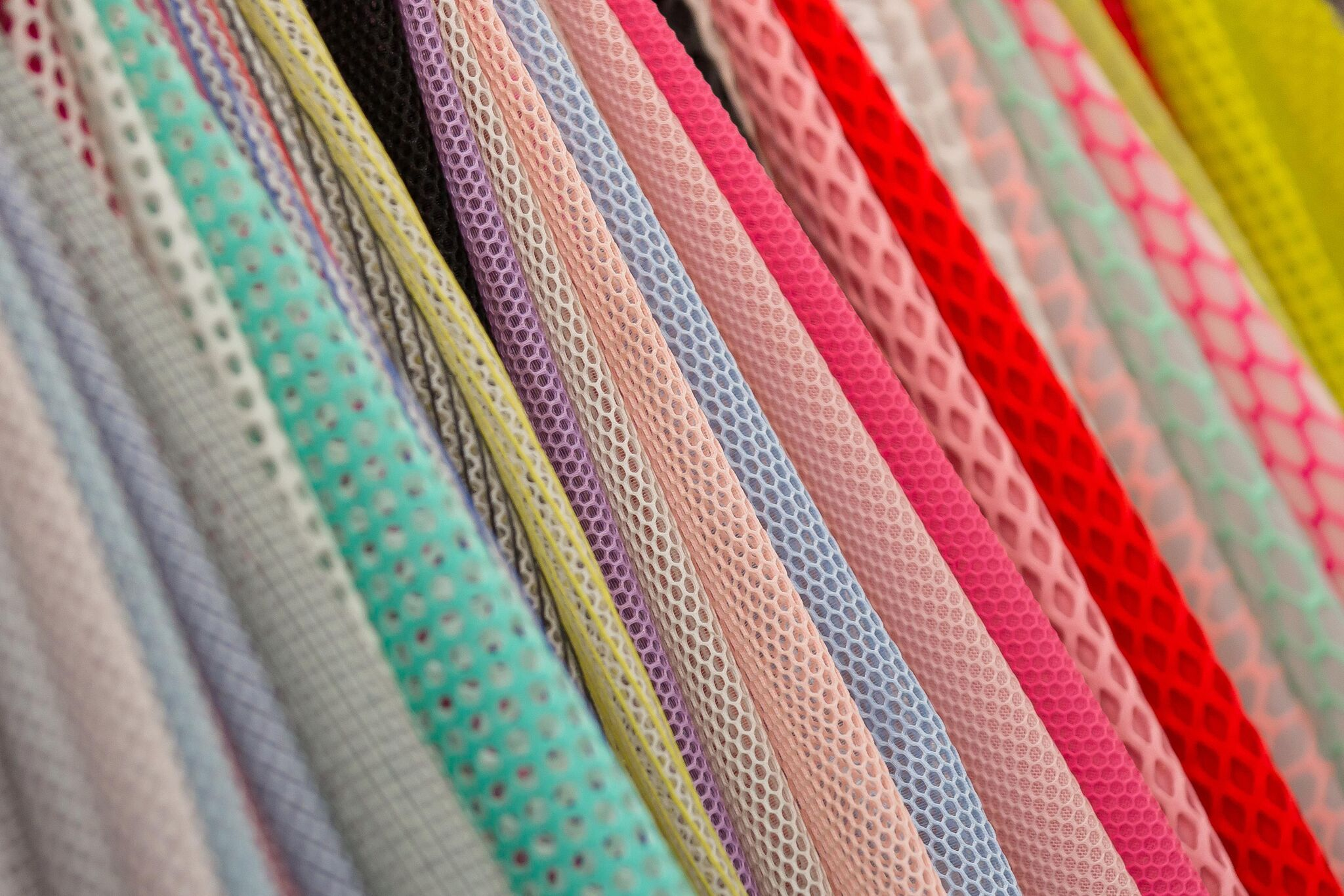 A selection of brightly colored fabrics at Texworld USA. Courtesy of Messe Frankfurt North America.