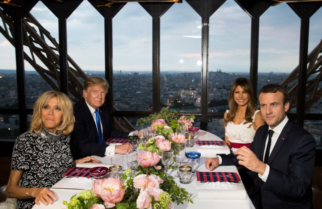 President Donald Trump, first lady Melania Trump, French President Emmanuel Macron his wife Brigitte Macron, sit for dinner at the Jules Verne Restaurant on the Eiffel Tower in Paris, Thursday, July 13, 2017. (AP Photo/Carolyn Kaster)
