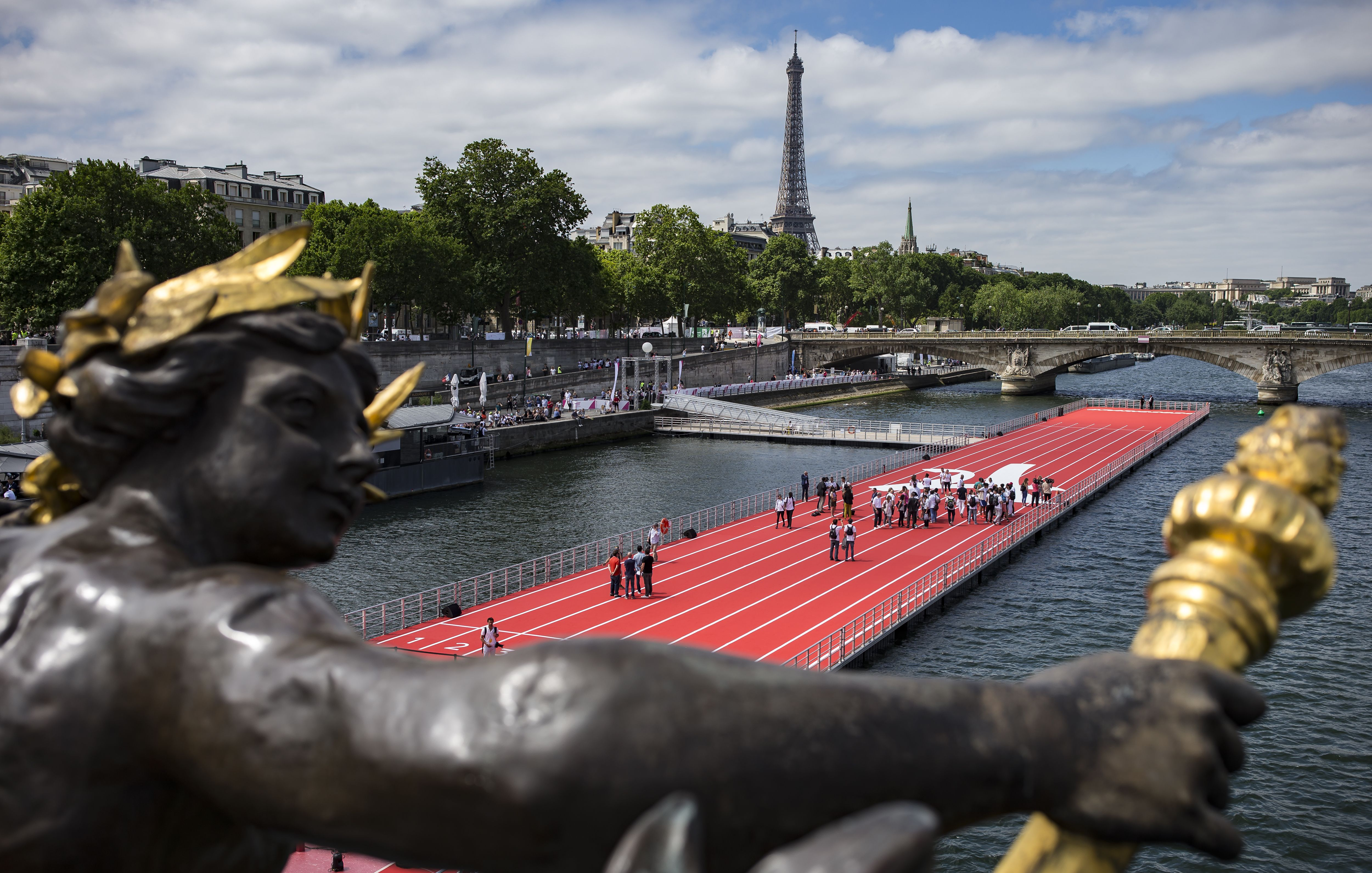 A view from the Pont Alexandre III of an athletics track floating on the river Seine in Paris, France, 23 June 2017. In an effort to promote the 2024 Paris Olympic bid, sporting venues open to the public are set up throughout the city for one day.Paris 2024 olympic promotion in Paris, France - 23 Jun 2017