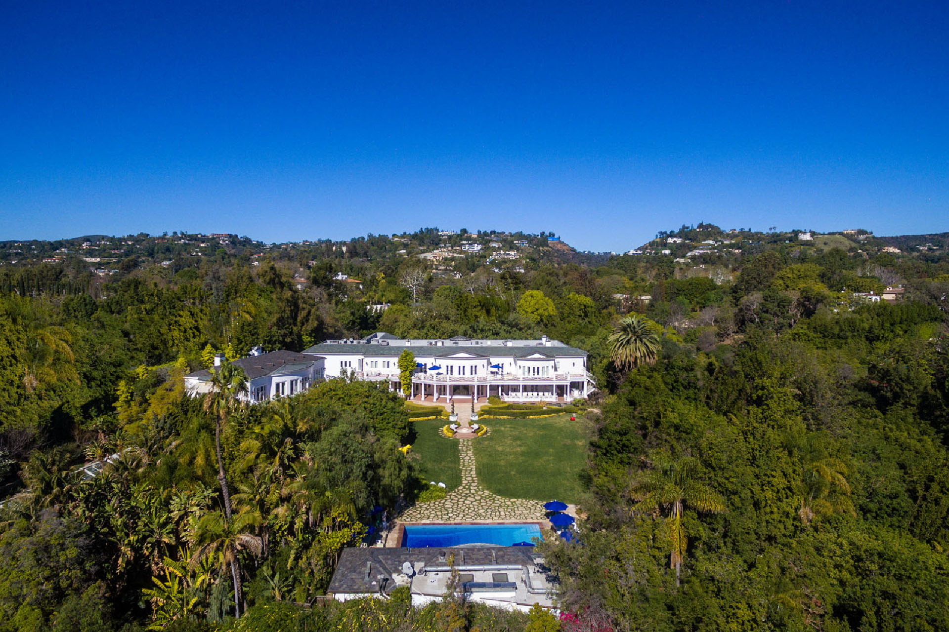 Max Azria's sprawling mansion is on the market for $88 million.