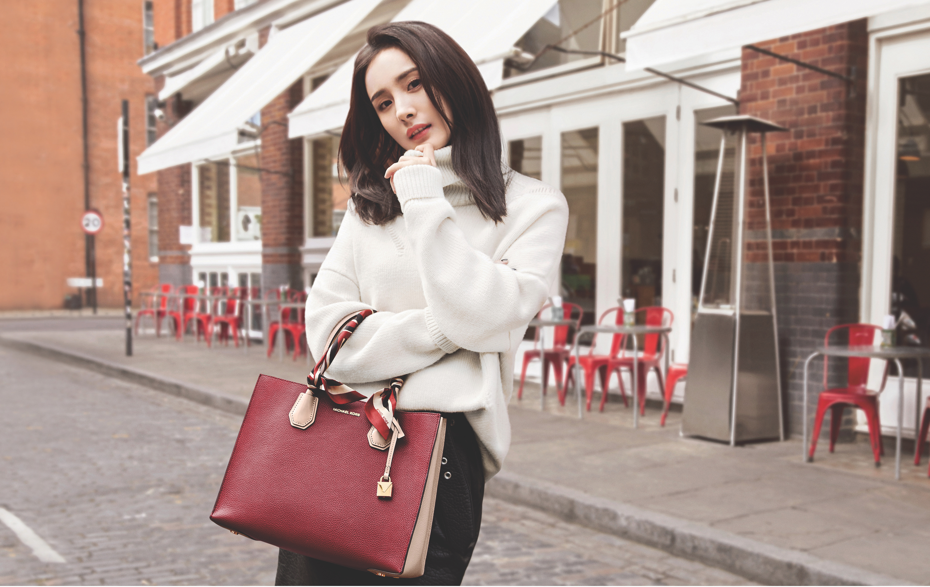 One of China's most popular actresses, Yang Mi, models a Mercer handbag from Michael Kors, exclusively available at DFS. The special collaboration with the duty free retailer launches Sept. 1st.