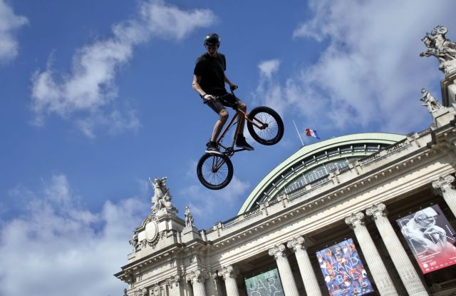 Belgian biker Kenneth Tancre performs outside the Grand Palais museum in Paris, . Paris is aiming to boost its bid for the 2024 Olympics by turning some of its world-famous landmarks over to sports for two days, with 100-meter races on a track floating on the Seine, high-diving into the river, cycling around the Arc de Triomphe and other events to showcase the French capital's suitability for the games2024, Paris, France - 23 Jun 2017