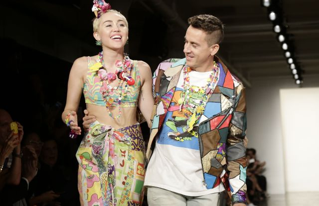 Us Singer Miley Cyrus (l) Walks on the Runway with Us Designer Jeremy Scott (r) at the Conclusion of His Spring 2015 Collection During Mercedes-benz Fashion Week in New York New York Usa 10 September 2014 the Spring 2015 Collections Are Presented From 04 to 11 September United States New YorkUsa New York Fashion Week - Sep 2014
