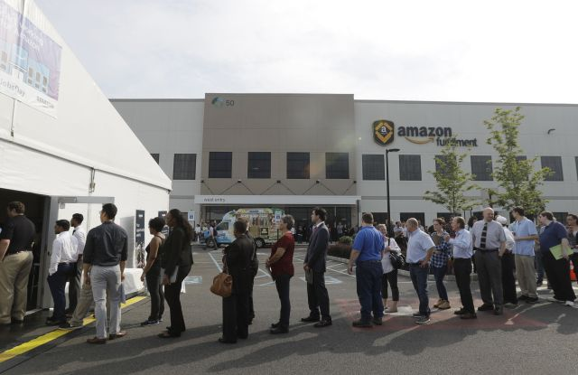 Job candidates form a line during a job fair at the Amazon Fulfillment center in Robbinsville Township, N.J., . Amazon held a nation-wide job fair at its warehouses on Aug. 2Amazon warehouse job fair, Robbinsville Township, USA - 02 Aug 2017