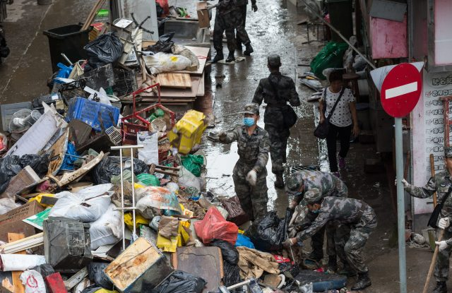 China's People Liberation Army (PLA) soldiers help to clean up debris brought by typhoon Hato in Macau.