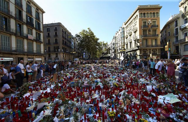 Flowers and candles are placed in tribute to victims of the terrorist attack in Las Ramblas boulevard in Barcelona, Spain, 24 August 2017. At least 15 people were killed and some 130 others injured after cars crashed into pedestrians on the La Rambla boulevard in Barcelona and on a promenade in the coastal city of Cambrils on 17 August. The so-called 'Islamic State' (IS) claimed responsibility for the attacks in Barcelona and Cambrils.Tributes to terrorist attacks victims, Barcelona, Spain - 24 Aug 2017