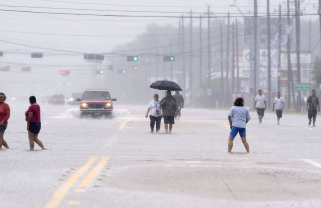 Residents walk along the flooded roadway of Texas 249 as they evacuate their adjacent neighborhoods near T. C. Jester Blvd. in Houston, Texas, USA, 27 August 2017. The areas in and around Houston and south Texas are experiencing record floods after more than 24 inches of rain after Harvey made landfall in the south coast of Texas as a category 4 hurricane, the most powerful to affect the US since 2004. Harvey has weakened and been downgraded to a tropical storm and is expected to cause heavy rain for several days.Major flooding hits the city of Houston, Texas after Hurricane Harvey makes landfall as a tropical storm, USA - 27 Aug 2017